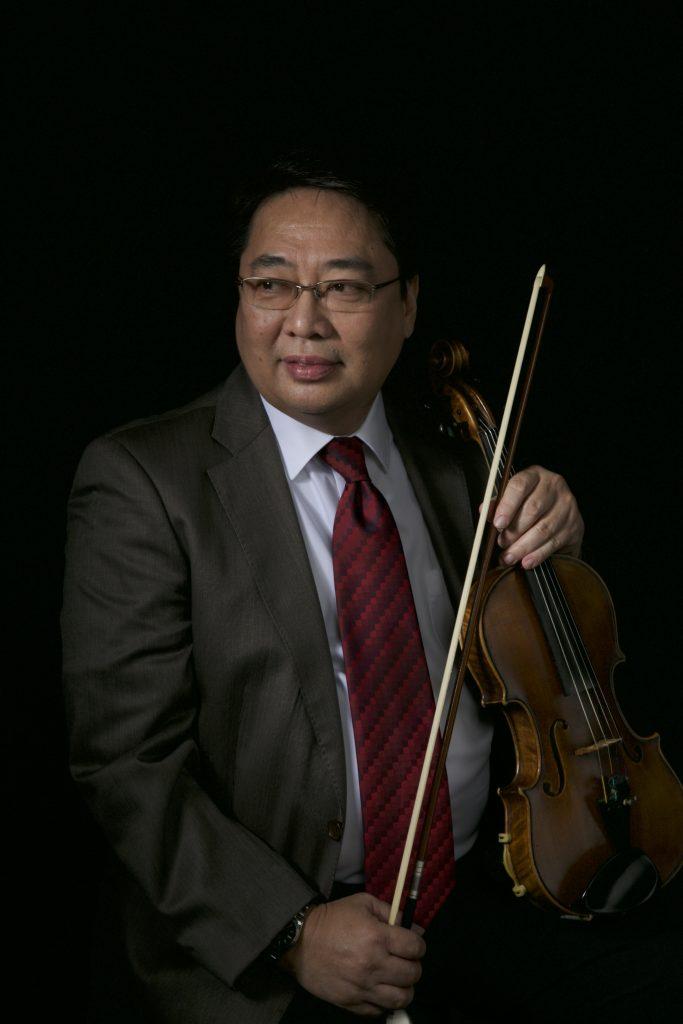 bernie pasamba posing holding a string instrument violin