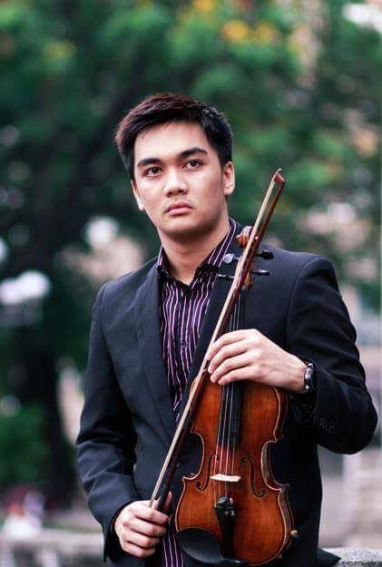 photo of a string musician, violinist posing, outdoors